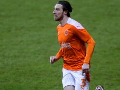 James Husband suffered a calf injury in the warm-up ahead of Blackpool's weekend win over Charlton (Richard Sellers/PA)