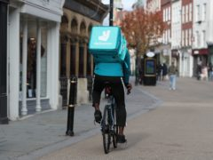 A Deliveroo rider on Worcester High Street (David Davies/PA)