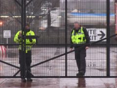 Border Force officers wait at a checking facility near Belfast Port (David Young/PA)