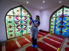 Practice nurse Hannah Currie, 25, prepares a dose of the AstraZeneca vaccine at Bradford Central Mosque, which is housing a community Covid-19 vaccination centre (Peter Byrne/PA)