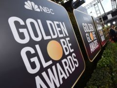 Signs above the red carpet at the Golden Globe Awards in 2020, when Britain first enjoyed a record 10 wins (Jordan Strauss/AP)