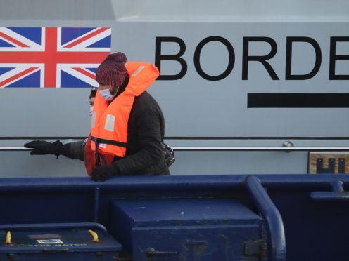 A group of people thought to be migrants are brought in to Dover (Gareth Fuller/PA)