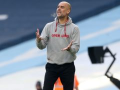 Manchester City manager Pep Guardiola is concerned about the state of the pitch at the Etihad Stadium (Martin Rickett/PA)