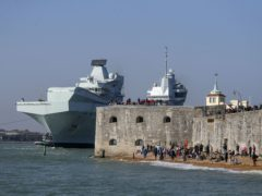 The Royal Navy aircraft carrier HMS Queen Elizabeth leaves Portsmouth Naval Base in Hampshire as it sets sail for exercises at sea (Steve Parsons/PA)