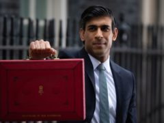 Rishi Sunak outside 11 Downing Street before heading to the House of Commons to deliver his Budget (Aaron Chown/PA)