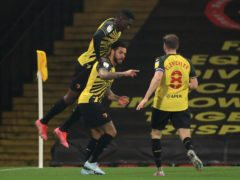 Watford's Andre Gray (centre) celebrates with team-mates Ismaila Sarr (left) and Tom Cleverley (Mike Egerton/PA)