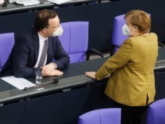 German chancellor Angela Merkel, right, speaks with the country's health minister Jens Spahn (Markus Schreiber/AP)