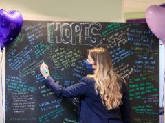Associate vice principal Hannah Smith writing a welcome back messages for students at Outwood Academy Adwick in Doncaster (Danny Lawson/PA)