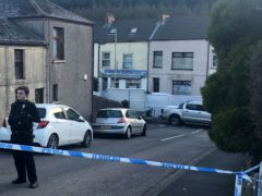 Police at the scene in the village of Ynyswen in Treorchy (Adam Hale/PA)