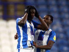 Yaya Sanogo, left, missed a penalty for Huddersfield (Tim Goode/PA)