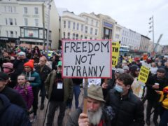People part in a demonstration against lockdown restrictions organised by the People's Convention in Cork (PA)