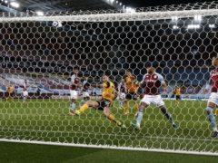 Romain Saiss shoots over during Wolves' 0-0 draw at Aston Villa (Peter Cziborra/PA)