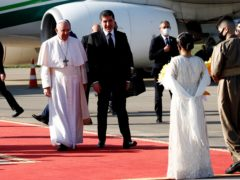 Pope Francis is welcomed by Kurdish President Nechirvan Barzani on arrival at Irbil airport in Iraq on Sunday (Hadi Mizban/AP)