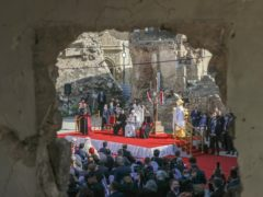 Pope Francis surrounded by shells of destroyed churches (Andrew Medichini/AP)