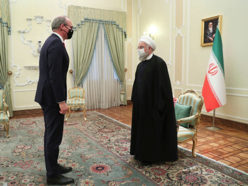 Iranian President Hassan Rouhani, right, and Irish Foreign Minister Simon Coveney greet each other at the start of their meeting in Tehran (Iranian Presidency Office.AP)