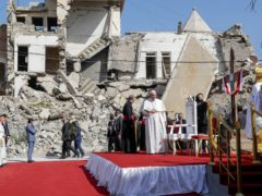 Pope Francis, surrounded by shells of destroyed churches, prays for the victims of war at Hosh al-Bieaa Church Square in Mosul, Iraq (Andrew Medichini/AP)