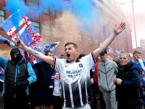 Rangers fans celebrate outside of the Ibrox Stadium after Rangers win the Scottish Premiership title. Picture date: Sunday March 7, 2021.