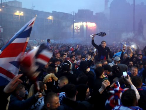 Rangers fans celebrate in George Square (Jane Barlow/PA)
