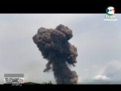 Smoke rises over the military barracks in Bata (TVGE via AP)