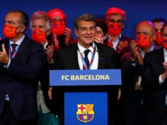 Joan Laporta, centre, will serve a second term as Barcelona president (Joan Monfort/AP/PA)