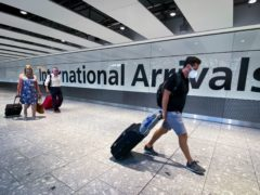 Passengers in the arrivals hall at Heathrow Airport (Aaron Chown/PA)