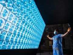 Trauma and orthopaedic surgeon Frank Acquaah looks at the Tunnel Of Light at Guy's and St Thomas' Hospital in London (Dominic Lipinski/PA)