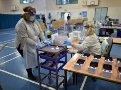 Staff process lateral flow tests at Archway School in Stroud, Gloucestershire, as pupils in England return to school for the first time this year (Ben Birchall/PA)