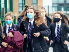 Students arrive at Outwood Academy in Woodlands, Doncaster in Yorkshire, as pupils in England return to school for the first time in two months as part of the first stage of lockdown easing. Picture date: Monday March 8, 2021.