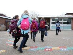Children arrive at Manor Park School and Nursery in Knutsford, Cheshire, as pupils in England return to school for the first time in two months as part of the first stage of lockdown easing. Picture date: Monday March 8, 2021.