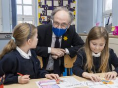 Northern Ireland Education Minister Peter Weir during a visit to a Primary 3 class at Springfield Primary School in Belfast (Liam McBurney/PA)