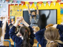 P3 teacher Jessica Cargill with her class at Springfield Primary School in Belfast (PA)