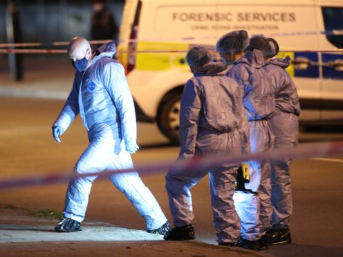 Forensics outside Poynders Court in south London as the search for missing woman Sarah Everard continues (Yui Mok/PA)