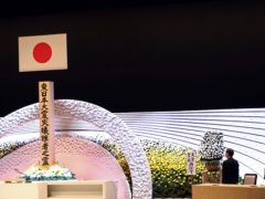 Japan's Emperor Naruhito and Empress Masako pay their respects in front of the altar for the 2011 earthquake and tsunami victims (Behrouz Mehri/AP)