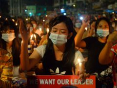 Protesters attend a candlelight night rally in Yangon, Myanmar (AP Photo)