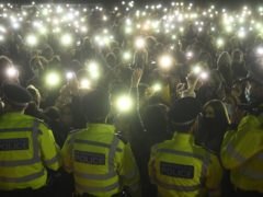 People in the crowd turn on their phone torches in Clapham Common, London (Victoria Jones/PA)
