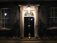 A candle lit by Prime Minister Boris Johnson and his fiancee Carrie Symonds (Aaron Chown/PA)
