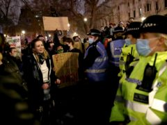 Police and protesters in Parliament Square (Aaron Chown/PA)