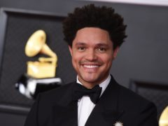 Comedian Trevor Noah opened the Grammy Awards with a joke about the royal family as Harry Styles kicked off the performances (Jordan Strauss/Invision/AP)