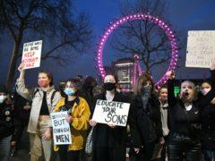 Demonstrators protest outside New Scotland Yard following the killing of Sarah Everard (Dominic Lipinski/PA)