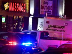 Authorities investigate a fatal shooting at a massage parlour (Mike Stewart/AP)