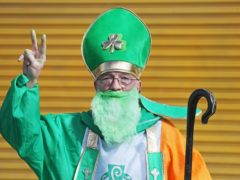 A man dressed as St Patrick on O'Connell Street in Dublin (Brian Lawless/PA)