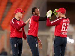Jofra Archer, center, claimed four wickets for England (Ajit Solanki/AP)