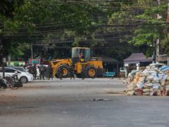 Police and military occupy a roadblock in Yangon, Myanmar (AP Photos)