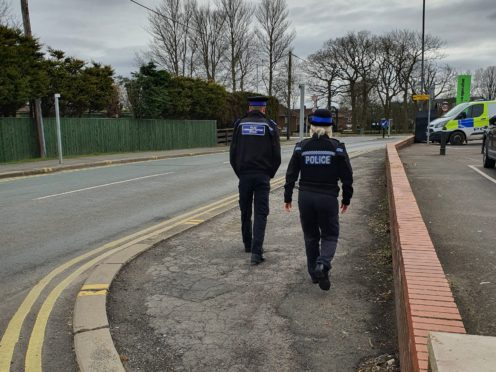 A community support officer and police officer in Wingate, following a former Royal Marine having had his bungalow torched for a second time (Durham Police/PA)