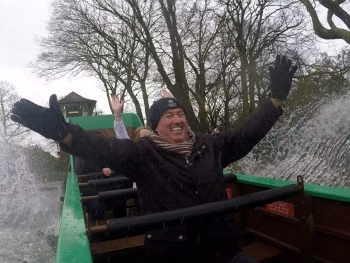 Cllr Dave Craker takes a ride on the listed Wicksteed splash boat in Hull's East Park (Richard McCarthy/PA)