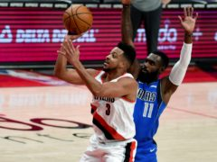 CJ McCollum, left, and Damian Lillard combined for more than 60 points as their Portland Trail Blazers finished 125-119 over the Dallas Mavericks (Steve Dykes/AP)