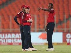 Jofra Archer, right, interacts with captain Eoin Morgan (Ajit Solanki/AP)