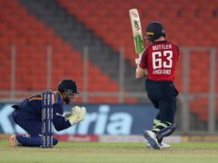 Jos Buttler, right, was unable to help England to victory (Ajit Solanki/AP)