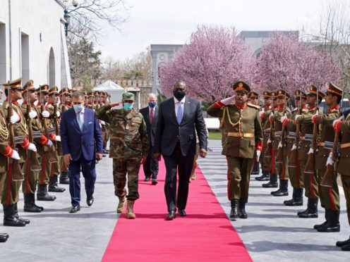 US Defence Secretary Lloyd Austin walks with Acting Afghan Minister of Defence Yasin Zia as they review an honour guard at the presidential palace in Kabul (Presidential Palace via AP)
