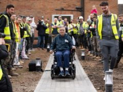 Rob Lamb is shown around the modified garden at his home in Solihull (Jacob King/PA)